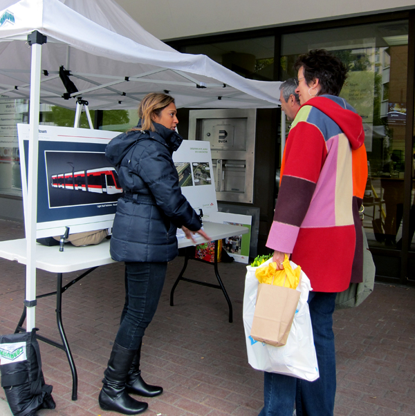 Crosstown Community Liaison speaks with community members at the Mount Pleasant Fall Fair in 2011